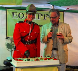 The Consul General of Canada, Dale Eisler, came down to give a speech and he had one of the Canadian Mounted Police cut the cake.