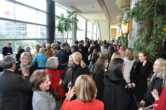 Guests are mingling before the luncheon