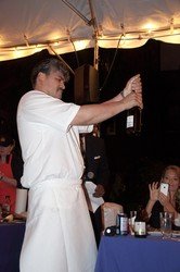 Chef Villalovos corks a bottle of beer, which was chosen to be paired with his teams entry.
