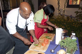 Chef Robert Gadsby of Ridgewells, and team Ridgewells, cuts up and de-seeds jalapeno chilis in preparation of a salsa.