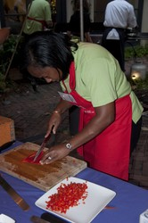 Annette Andrews of the Ridgewells team juliennes her red bell peppers before dicing them.